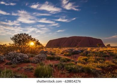ULURU, AUSTRALIA - CIRCA AUGUST 2016: Sun rising over Uluru, Uluru-Kata Tjuta National Park, Northern Territory, Australia