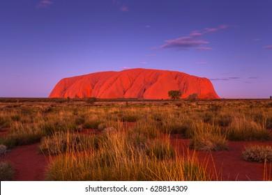 ULURU, AUSTRALIA - CIRCA AUGUST 2016: Approaching dusk at Uluru on a clear winter evening, Uluru-Kata Tjuta National Park, Northern Territory, Australia