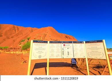 Uluru, Northern Territory, Australia - Aug 23, 2019: warning signs at Mala Parking. Please do not climb Uluru sign.Uluru is sacred to Anangu people traditional owners of Uluru-Kata Tjuta National Park