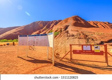 Uluru, Northern Territory, Australia - Aug 26, 2019: closed path for strong wind. Warning signs at Mala Parking. Uluru is sacred to Anangu people traditional owners of Uluru-Kata Tjuta National Park.