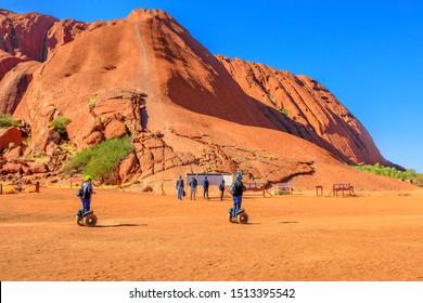 Uluru, Northern Territory, Australia - Aug 26, 2019: Uluru Segway Tours at Mala Parking in front of Ayers Rock Climb in Uluru-Kata Tjuta National Park Aboriginal Land.