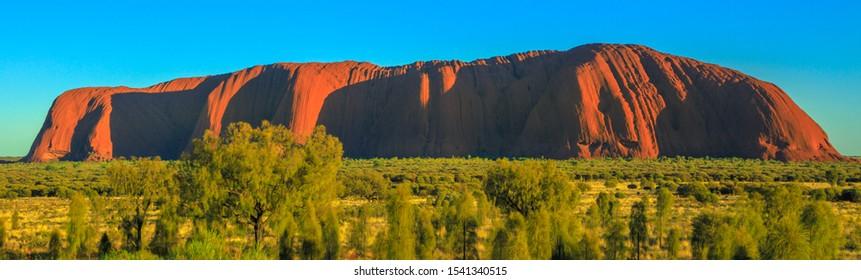 Uluru, Northern Territory, Australia - Aug 23, 2019: panorama of Uluru monolith from Talinguru Nyakunytjaku sunrise area in Uluru-Kata Tjuta National Park. Aboriginal land in Australian Red Centre.