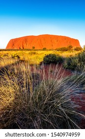 Uluru, Northern Territory / Australia - May 18 2018: Sunrise at Uluru with colourful sky and desert