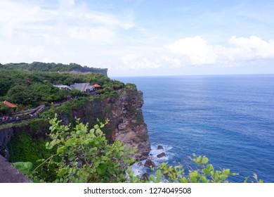 "Uluwatu, Bali, Indonesia - June 25th, 2017 : A Pura (place for Hindu people to pray), located on the edge of a cliff. Hence the name, Pura Uluwatu : ""ulu"" (edge) and ""watu"" (rock cliff)."