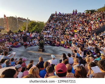 Uluwatu, Bali/Indonesia: August 22nd 2018: Famous tourist attraction kecak dance at sunset in arena overcrowded with people