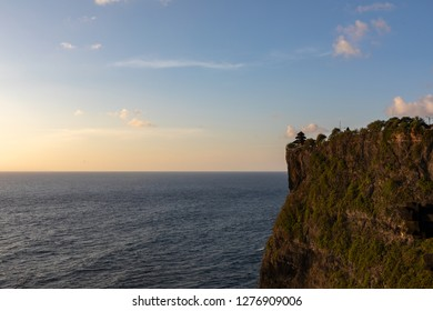 Uluwatu Temple in Bali, Indonesia by the Ocean at Sunset