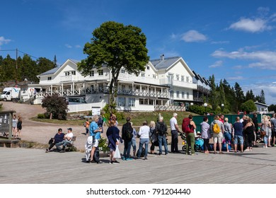 ULVON, SWEDEN ON JULY 18. Exterior of the local hotel and restaurant on July 18, 2017 in Ulvon, Sweden. Line-up to the departure ship this side. Unidentified person.