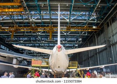 ULYANOVSK, RUSSIA - AUGUST 19, 2018: Sukhoi Civil Aircraft company Sukhoi Superjet 100 SSJ 100 twin engine passenger jet plane at exhibition