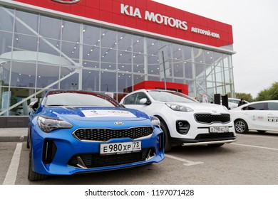 Ulyanovsk, Russia - October 06, 2018: Exhibition cars stands in front of the building of KIA MOTORS car selling and service center.