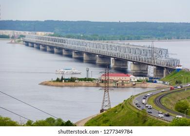 Ulyanovsk/Russia - May 25, 2018: The Imperial Bridge across the Volga. A bridge across the Volga river in spring in Ulyanovsk, Russia. The view from the top of the embankment of the Volga.