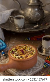 Um Ali, which mean the Mother of Ali. It is a traditional oriental dessert that contains bread, mild and some nuts.