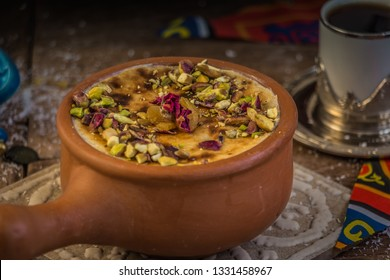 Um Ali, which mean the Mother of Ali. It is a traditional oriental dessert that contains bread, milk and some nuts.