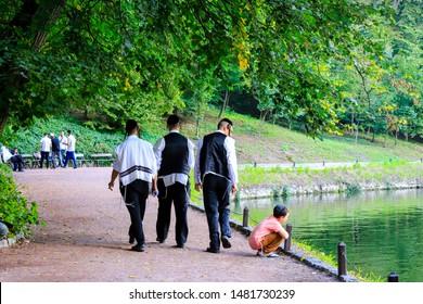 Uman, Ukraine 11.09 2018. A group of boys, a family of Hasidic Jews, walks in Uman park, the Jewish New Year,  religious Orthodox Jew
