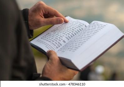 UMAN, UKRAINE SEPTEMBER 15, 2015: Man holding Mahzor â?? prayer book used by Jews on the High Holidays of Rosh Hashanah and Yom Kippur. Religious book Mahzor. Rosh Hashanah.
