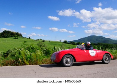 UMBERTIDE (PG) ITALY - MAY 17: Red Fiat Stanguellini 1100 sport, built in 1947, takes part to the 1000 Miglia, on May 17, 2013 in Umbertide (PG)