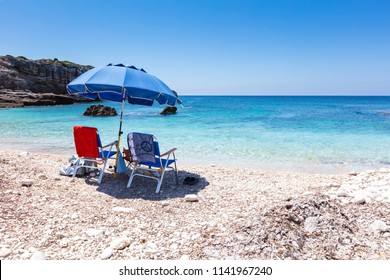 Umbrell with two chairs on the beach