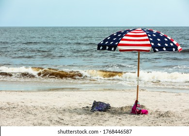 Umbrella with American Flag print on a Beach at the Ocean in North Carolina