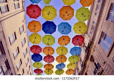 The Umbrella arts project in Liverpool Church Alley to raise awareness of ADHD and autism. Umbrella suspended from the roof of buildings, Liverpool city, England UK. September 2018