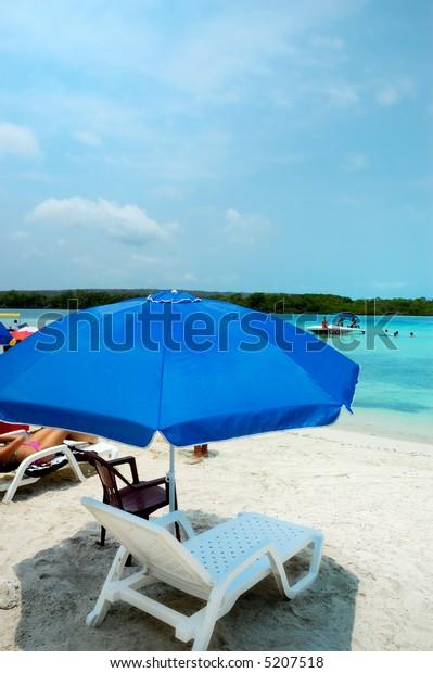 Umbrella in a Caribbean shallow water beach