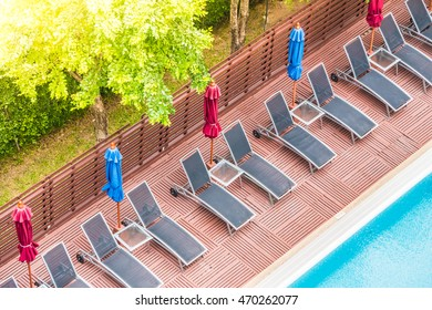 Umbrella and chair around outdoor swimming pool in beautiful luxury hotel and resort - Sunflare filter