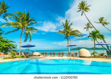 Umbrella and chair around swimming pool in hotel and resort for travel and vacation