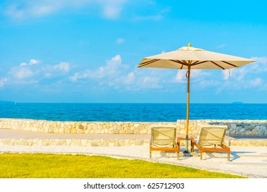 Umbrella and chair with beautiful tropical sea view