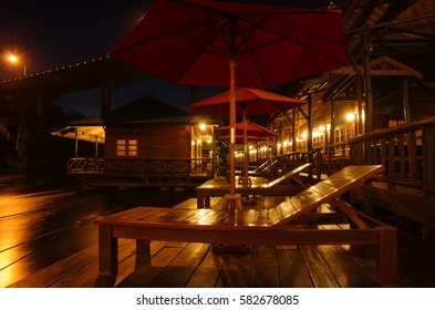 umbrella and chair to night in resorts at thailand