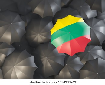 Umbrella with flag of lithuania on top of black umbrellas. 3D illustration