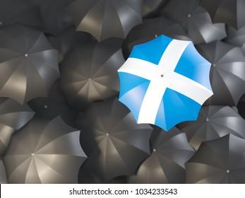 Umbrella with flag of scotland on top of black umbrellas. 3D illustration