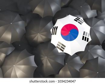 Umbrella with flag of south korea on top of black umbrellas. 3D illustration