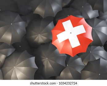 Umbrella with flag of switzerland on top of black umbrellas. 3D illustration
