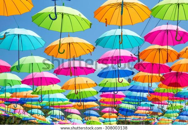 An umbrella and a fountain