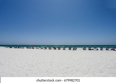 umbrella lined beach in destin florida