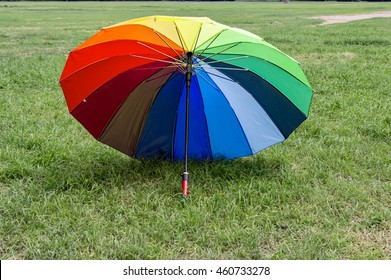 Umbrella with many colors on the ground.