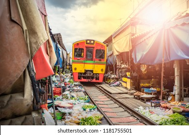Umbrella market Maeklong Railway Train Market in Maeklong Samut Songkhram Thailand