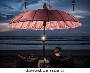 Umbrella at night / at the tropical beach