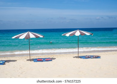 The Umbrella on the beach and a mattress in the sunny day with blue sky and blue sea  in Thailand