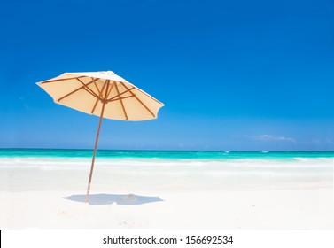 Umbrella on perfect caribbean beach in Tulum