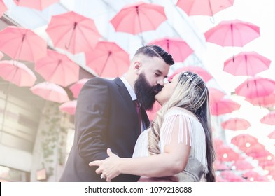 lot umbrella on the  street, couple kissing and loving