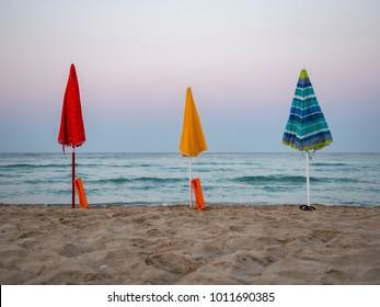 Umbrella on wild beach