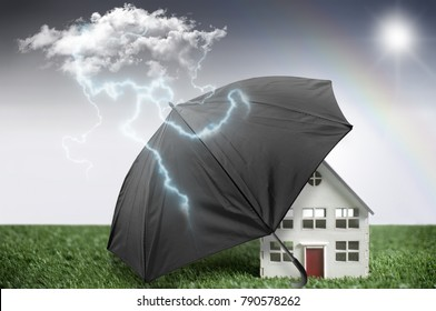 Umbrella protecting a house from bad weather