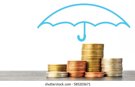 Umbrella protection money,Coverage, insurance or Protection concept, Stacks and heaps of coins