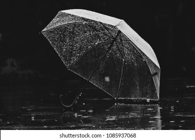 Umbrella in the rain vintage tone