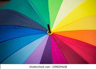 Umbrella with rainbow colors, symbolic,