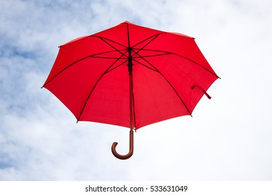 Umbrella and sky close-up.