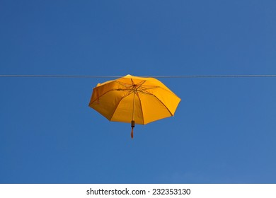 Umbrella in the sky on a rope horizontal