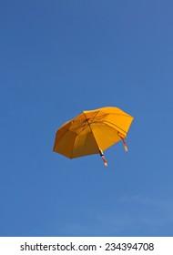 Umbrella in the sky vertical