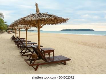 Umbrellas and beach chairs on the beach in Thailand.