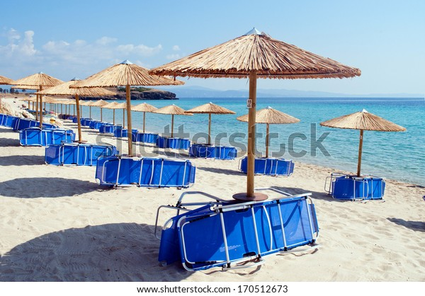 Umbrellas and chairs ready for the tourists on the beach