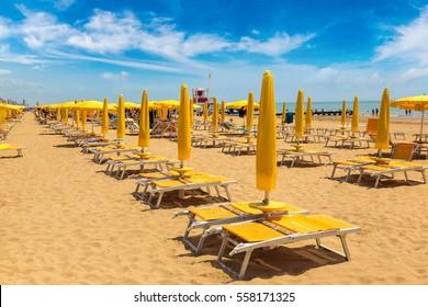 Umbrellas on the beach of Lido di Jesolo at adriatic Sea in a beautiful summer day, Italy